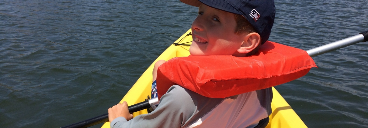 Kayaking is just one of the fun things kids can do at summer camp.